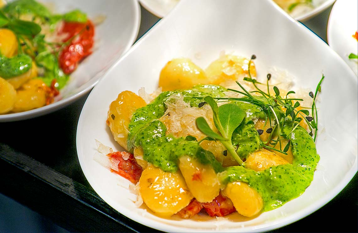 Vegetables with green sauce and herbs